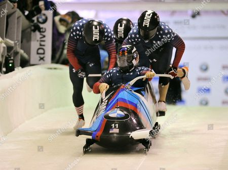 Steven Holcomb, Carlo Valdes, James Reed, Samuel McGuffie Driver Steven Holcomb, Carlo Valdes, James Reed and brakeman Samuel McGuffie, of the United States, start a run in the four-man bobsled World Cup event, in Lake Placid, N.Y