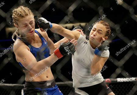 Michelle Waterson, right, punches Paige VanZant during the first round of a UFC Fight Night mixed martial arts fight in Sacramento, Calif., . Waterson won by submission in the first round