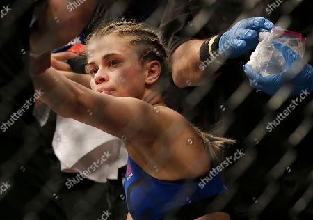 Paige VanZant reacts after losing to Michelle Waterson in a UFC Fight Night mixed martial arts fight in Sacramento, Calif., . Waterson won by submission in the first round