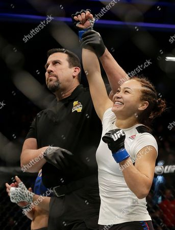 Michelle Waterson, right, has her hand raised after beating Paige VanZant in a UFC Fight Night mixed martial arts fight in Sacramento, Calif., . Waterson won by submission in the first round
