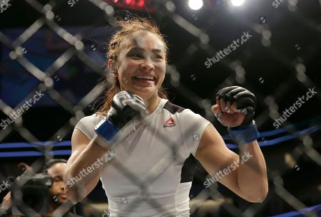 Michelle Waterson celebrates after beating Paige VanZant in a UFC Fight Night mixed martial arts fight in Sacramento, Calif., . Waterson won by submission in the first round