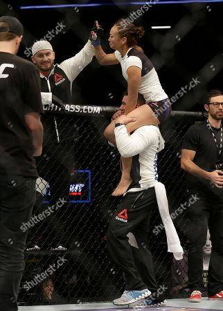 Michelle Waterson, top, celebrates after beating Paige VanZant in a UFC Fight Night mixed martial arts fight in Sacramento, Calif., . Waterson won by submission in the first round