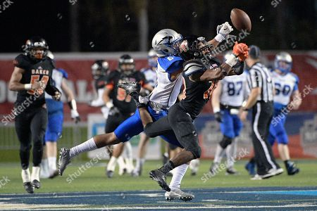 Rocky James, Avery Parker Baker defensive back Avery Parker (20) breaks up a pass intended for St. Francis receiver Rocky James (6) during the second half of the NAIA championship football game in Daytona Beach, Fla., . St. Francis won 38-17