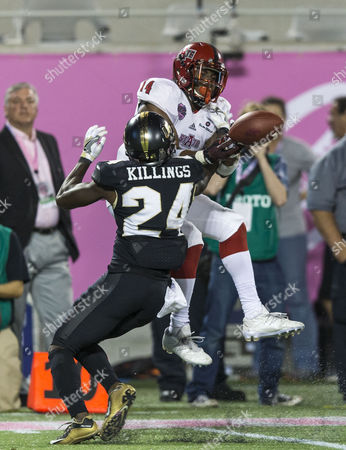 UCF Knights defensive back D.J. Killings (24) defends Arkansas State Red Wolves wide receiver Chris Murray (14)in the game between the Arkansas State Red Wolves and the Central Florida Knights in the AutoNation Cure Bowl at Camping World Stadium in Orlando, Florida