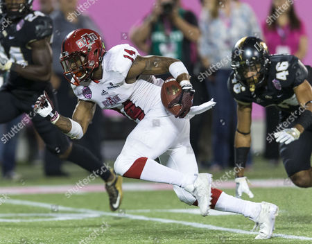 Arkansas State Red Wolves wide receiver Chris Murray (14) makes the catch and runs for a gain in the game between the Arkansas State Red Wolves and the Central Florida Knights in the AutoNation Cure Bowl at Camping World Stadium in Orlando, Florida
