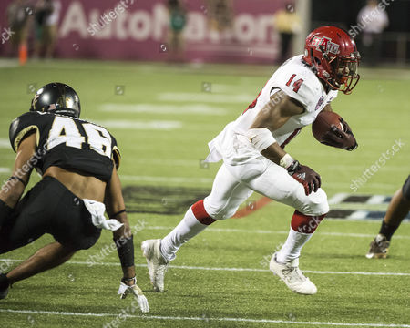 monthname} 17, - Orlando, FL, U.S: Arkansas State Red Wolves wide receiver Chris Murray (14) runs with the ball after a catch during the AutoNation Cure Bowl. Arkansas State defeated Central Florida 31-13 at Camping World Stadium in Orlando, Fl