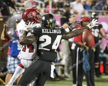 monthname} 17, - Orlando, FL, U.S: UCF Knights defensive back D.J. Killings (24) defends a pass intended for Arkansas State Red Wolves wide receiver Chris Murray (14) during the AutoNation Cure Bowl. Arkansas State defeated Central Florida 31-13 at Camping World Stadium in Orlando, Fl