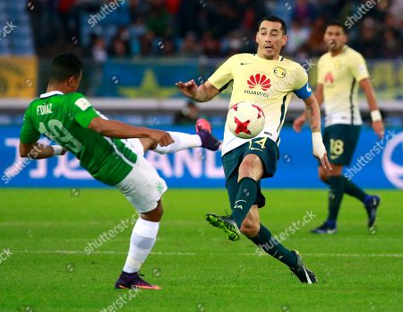 Farid Diaz, Rubens Sambueza Atletico Nacional's Farid Diaz, left, and Club America's Rubens Sambueza vie for the ball during their match for the third place at the FIFA Club World Cup soccer tournament in Yokohama, near Tokyo