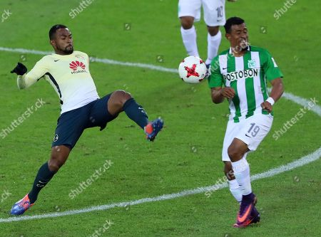 William Da Silva, Farid Diaz Club America's William Da Silva, left, and Atletico Nacional's Farid Diaz vie for the ball during their match for the third place at the FIFA Club World Cup soccer tournament in Yokohama, near Tokyo
