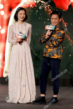 """Tony Leung, Du Juan Hong Kong actor Tony Leung, right, and Chinese model Du Juan share a light moment on stage as they attend a press conference for their latest movie """"See You Tomorrow"""" in Beijing, . The movie will open in China on Dec. 23"""