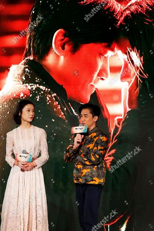 """Tony Leung, Du Juan Hong Kong actor Tony Leung, right, speaks next to Chinese model Du Juan as they attend a press conference to promote their latest movie """"See You Tomorrow"""" in Beijing, . The movie will open in China on Dec. 23"""