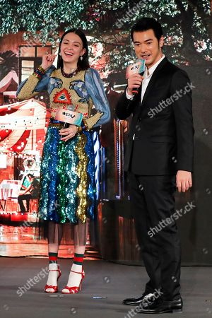 """Takeshi Kaneshiro, Sandrine Taiwanese-Japanese actor Takeshi Kaneshiro, right, shares a light moment with Taiwanese actress Sandrine Pinna during a press conference to promote their latest movie """"See You Tomorrow"""" in Beijing, . The movie will open in China on Dec. 23"""