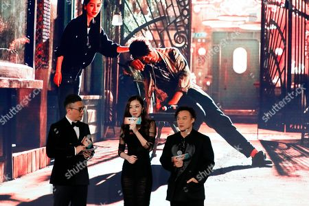 """Lynn Hung, Eason Chan Hong Kong model and actress Lynn Hung, center, speaks next to Hong Kong singer Eason Chan, right, during a press conference to promote their latest movie """"See You Tomorrow"""" in Beijing, . The movie will open in China on Dec. 23"""
