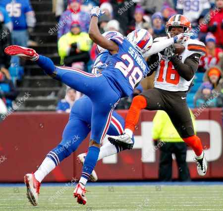 Cleveland Browns wide receiver Andrew Hawkins, right, makes a catch as Buffalo Bills cornerback Ronald Darby (28) and cornerback Corey White (30) defend on the play during the second half of an NFL football game, in Orchard Park, N.Y