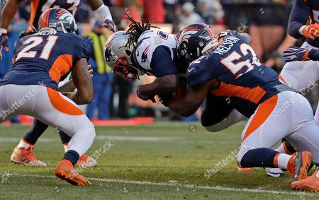 New England Patriots running back LeGarrette Blount scores between Denver Broncos cornerback Aqib Talib, left, and inside linebacker Corey Nelson during the first half of an NFL football game, in Denver