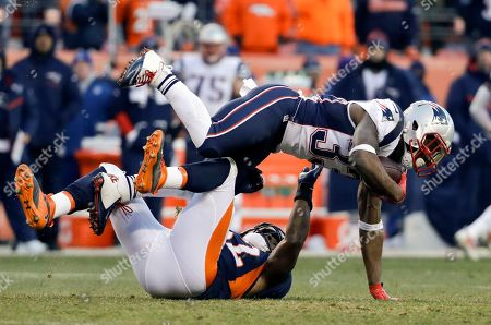 New England Patriots running back Dion Lewis, top, is tackled by Denver Broncos inside linebacker Corey Nelson during the second half of an NFL football game, in Denver