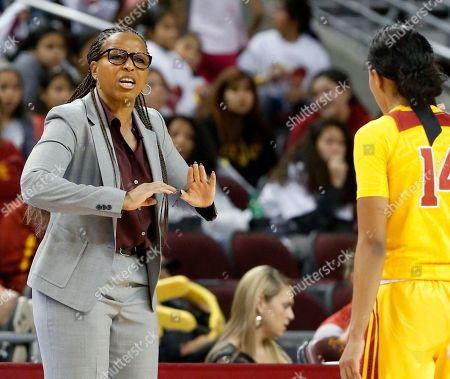 Southern California coach Cynthia Cooper-Dyke talks to her players in the second half of an NCAA women's basketball game against Mississippi State in Los Angeles on . Mississippi State won 76-72