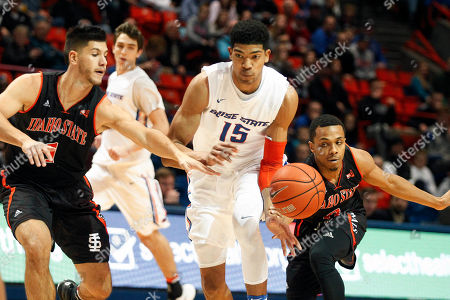 Chandler Hutchison, Geno Luzcando, Ethan Telfair Boise State's Chandler Hutchison (15) moves the ball between Idaho State's Geno Luzcando (1) and Ethan Telfair during the first half of an NCAA college basketball game in Boise, Idaho