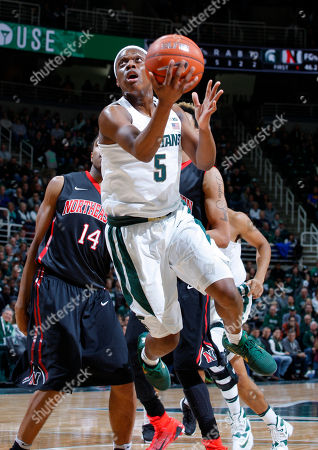 Cassius Winston, Maxime Bousiquot, Jeremy Miller Michigan State's Cassius Winston (5) goes up for a layup against Northeastern's Maxime Bousiquot (14) and Jeremy Miller during the first half of an NCAA college basketball game, in East Lansing, Mich
