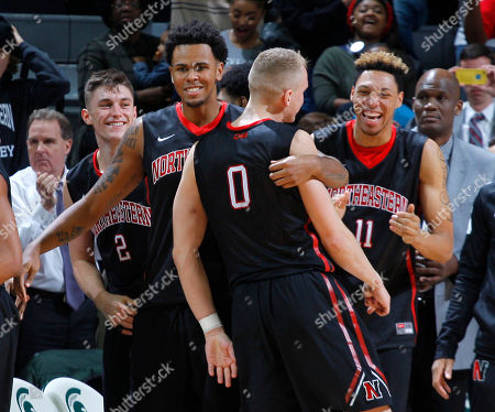 Alex Murphy, Bolden Brace, Anthony Green, Jeremy Miller Northeastern players, including Alex Murphy (0), Bolden Brace (2), Anthony Green and Jeremy Miller (11), celebrate following an 81-73 win over Michigan State in an NCAA college basketball game, in East Lansing, Mich