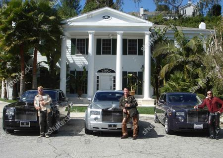 Stock Picture of Middle: Marcus Prinz von Anhalt, Prince Michael, Frederic Prinz von Anhalt with Rolls Royce cars in Los Angeles, USA