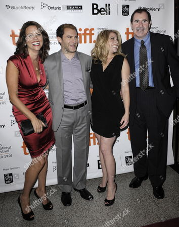 (l-r) Actors Amy Landecker Michael Stuhlbarg Sari Lennick and Richard Kind Pose On the Red Carpet For a Screening of Their Film a Serious Man at the 34th Annual Toronto International Film Festival in Toronto Canada On 12 September 2009
