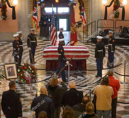The United States Marine honor guard performs a Changing of the Guard as former astronaut and U.S. Senator John H Glenn lies in repose, in the Rotunda of the Ohio Statehouse
