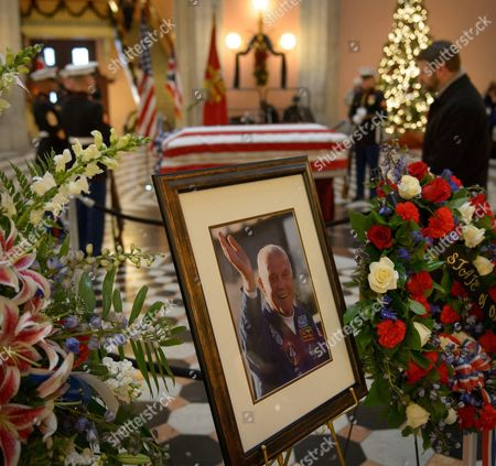Members of the public pay their respects to former astronaut and U.S. Senator John H Glenn as he lies in repose, under a United States Marine honor guard, in the Rotunda of the Ohio Statehouse