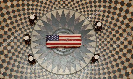 Former astronaut and U.S. Senator John H Glenn lies in repose, under a United States Marine honor guard, in the Rotunda of the Ohio Statehouse