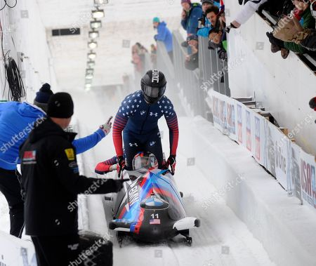 Steven Holcomb, Carlo Valdes, James Reed Samuel McGuffie Driver Steven Holcomb with Carlo Valdes, James Reed and brakeman Samuel McGuffie of the United States, in the finish area after a second place finish in the four-man bobsled World Cup race, in Lake Placid, N.Y