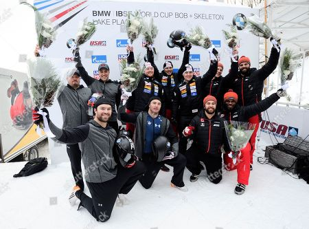 Rico Peter, Janne Bror van der Zijde, Simon Friedli, Thomas Andrianov, Steven Holcomb, Carlo Valdes, James Reed, Samuel McGuffie Chris Spring, Cameron Stones, Lascelles Brown, Samuel Giguere The Swiss team of Rico Peter, Janne Bror van der Zijde, Simon Friedli and Thomas Andrianov, center, celebrate their win in the four-man bobsled World Cup race, in Lake Placid, N.Y. United States, team of Steven Holcomb, Carlo Valdes, James Reed, Samuel McGuffie left, second place and Canada's team of Chris Spring, Cameron Stones, Lascelles Brown, Samuel Giguere third place, join the celebration