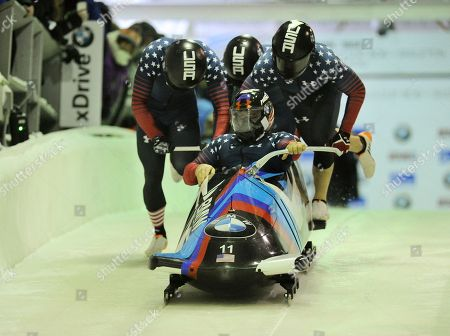 Steven Holcomb, Carlo Valdes, James Reed, Samuel McGuffie Driver Steven Holcomb with Carlo Valdes, James Reed and brakeman Samuel McGuffie of the United States, compete in the four-man bobsled World Cup race, in Lake Placid, N.Y