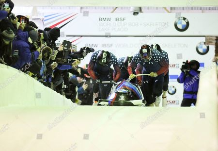 Steven Holcomb, Carlo Valdes, James Reed, Samuel McGuffie Driver Steven Holcomb with Carlo Valdes, James Reed and brakeman Samuel McGuffie, of the United States, compete in the four-man bobsled World Cup race, in Lake Placid, N.Y