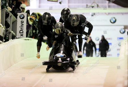 Stock Image of Lamin Deen, Mark Lewis-Francis, Andrew Matthews, Tremayne Gilling Driver Lamin Deen with, Mark Lewis-Francis, Andrew Matthews and brakeman Tremayne Gilling, of the United Kingdom, compete in the four-man bobsled World Cup race, in Lake Placid, N.Y