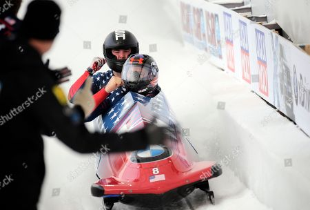 Steven Holcomb, Carlo Valdes Driver Steven Holcomb, front, and brakeman Carlo Valdes of the United States react in the finish area after second run of the mens two-man bobsled World Cup race winning the race with a combined score of 1:29:47, in Lake Placid, N.Y