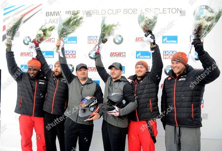 Steven Holcomb, Carlo Valdes, Justin Kripps, Jesse Lumsden, Chris Spring, Lascelles Brown First Place winners Steven Holcomb and Carlo Valdes of the United States, center, second place winners Justin Kripps and Jesse Lumsden of Canada, left, and third place finishers Chris Spring and Lascelles Brown of Canada, right, in the finish area after the mens' two-man bobsled World Cup race, in Lake Placid, N.Y