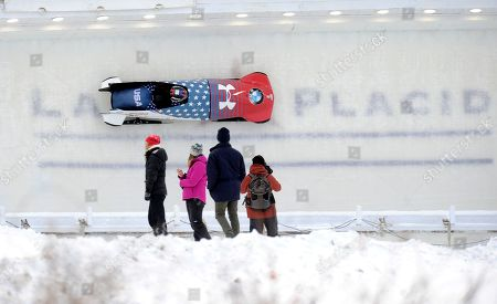 Steven Holcomb, Carlo Valdes Driver Steven Holcomb, front, and brakeman Carlo Valdes, of the United States, during their second run of the mens two-man win the bobsled World Cup race with a combined score of 1:29:47, in Lake Placid, N.Y