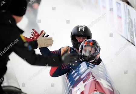 Steven Holcomb, Carlo Valdes Driver Steven Holcomb, front, and brakeman Carlo Valdes, of the United States, react in the finish area after second run of the mens two-man bobsled World Cup race with a combined score of 1:29:47, in Lake Placid, N.Y