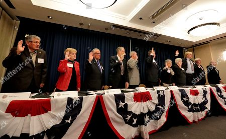 From left; Arizona Electoral College members Walter Begay Jr., Sharon Giese, Alberto Gutier, Jerry Hayden, Bruce Ash, Robert Graham, Carol Joyce, Jane Pierpoint Lynch, J. Foster Morgan, James O'Conor and Edward Robson, take their pledge of office prior to formally casting their ballots for President-elect Donald Trump at the Capitol in Phoenix