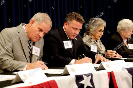 From left; Arizona Electoral College members Bruce Ash, Robert Graham, Carol Joyce, and Jane Pierpoint Lynch, cast their ballots for President-elect Donald Trump at the Capitol in Phoenix, . All 11 Arizona members cast their vote for Trump