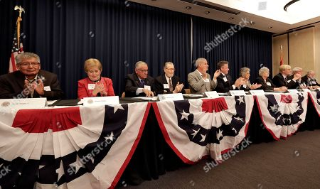 From left; Arizona Electoral College members Walter Begay Jr., Sharon Giese, Alberto Gutier, Jerry Hayden, Bruce Ash, Robert Graham, Carol Joyce, Jane Pierpoint Lynch, J. Foster Morgan, James O'Conor and Edward Robson prepare to cast their ballots for President-elect Donald Trump at the Capitol in Phoenix