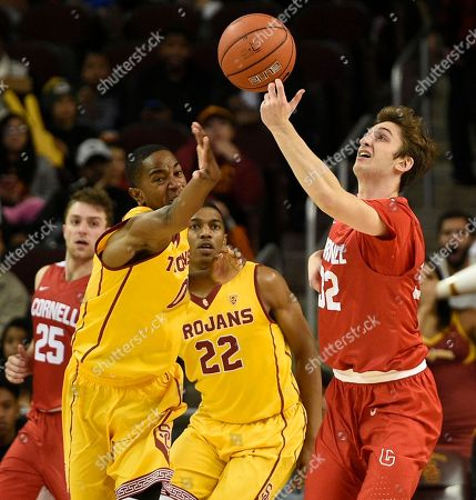 Stock Picture of Shaqquan Aaron, Jack Gordon Southern California guard Shaqquan Aaron, left, attempts to steal the ball from Cornell guard Jack Gordon during the second half of an NCAA college basketball game in Los Angeles, . Southern California won 79-67