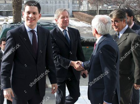 British Ambassador to Afghanistan Sherard Cowper-coles (c) Shakes Hands with Afghnistan's Foreign Minister Rangin Dafdar Spanta (r) As British Foreign Secretary David Miliband (l) Looks On Prior to a Joint Press Conference with His Afghan Counterpart Rangin Dafdar Spanta in Kabul Afghanistan On 18 February 2009 British Foreign Minister David Miliband Welcomed On 18 February an Announcement by the Us Government That It Will Send Thousands of Extra Troops to Afghanistan Saying They Would Play an Important Role in Defeating the Taliban-led Insurgency