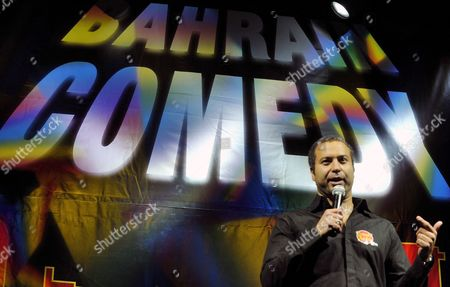 Egyptian-american Comedian From the Acclaimed Us-based Comedy Show Axis of Evil Ahmed Ahmed Performs a Stand-up Piece in Manama Bahrain 02 October 2008 Ahmed and Fellow Iranian-american Comedian and Actor Maz Jobrani Both Presented Their First of Two Stand-up Performances