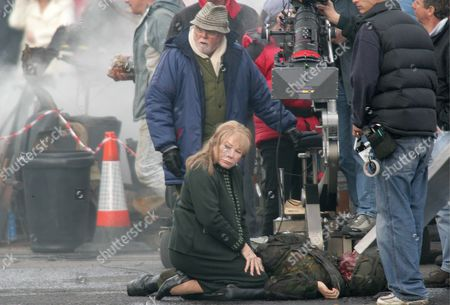 Richard Attenborough (l - Back) Watches Over Actress Shirley Maclaine (l - Front) As She Kneels Over of a Dying British Soldier During Filming in North Belfast Northern Ireland Thursday 20 April 2006 the Streets of Belfast Were Transformed Into a Movie Set As Some of Hollywood's Heaviest Hitters Began Making a New Film - Closing the Ring a Romantic Drama Based On a True Story That Evolved Over 50 Years Between Belfast and America the List of Stars Spotted in the North of the City Sounded Like a Roll Call For the Oscars: Richard Attenborough Pete Postlethwaite and Brenda Fricker Were Among Those Working Their Magic in the Streets Between Somerton Road and the Shore Road