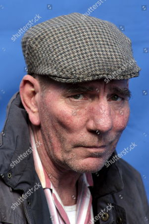 Actor Pete Postlethwaite Smiles As He Poses For Photographers During Filming in North Belfast Northern Ireland Thursday 20 April 2006 the Streets of Belfast Were Transformed Into a Movie Set As Some of Hollywood's Heaviest Hitters Began Making a New Film - Closing the Ring a Romantic Drama Based On a True Story That Evolved Over 50 Years Between Belfast and America the List of Stars Spotted in the North of the City Sounded Like a Roll Call For the Oscars: Richard Attenborough Pete Postlethwaite and Brenda Fricker Were Among Those Working Their Magic in the Streets Between Somerton Road and the Shore Road