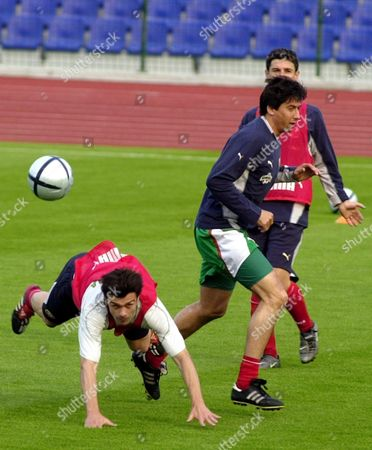 Players of Bulgarian National Soccer Team Rossen Kirilov (l) and Daniel Borimirov (r) in Action During a Training Session at the Vassil Levski Stadium in Sofia Bulgaria On Thursday 27 May 2004 Bulgaria Plays in the Euro 2004 Group C with Sweden Italy and Denmark