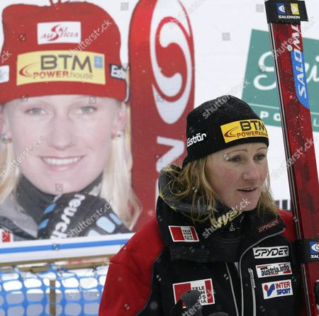 Second Place Finisher Renate Goetschl of Austria Poses For a Photographer in Front of a Sign with a Photograph of Her Made by Her Fans at the Women's World Cup Downhill in Lake Louise Alberta Saturday 04 December 2004 Germany's Hilde Gerg Won with a Time of One Minute 36 01 Seconds Followed by Austria's Renate Goetschl in Second with a Time of One Minute 36 16 Seconds and France's Carole Montillet-carles in Third at One Minute 36 20 Seconds