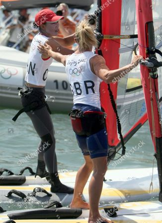 Bryony Shaw of Great Britain Who Won Bronze (r) Congratulates Yin Jian of China in the Rs:x Women's Windsurfing Event in Qingdao China 20 August 2008 Yin Jian's Gold Gave China Its First Ever Olympic Sailing Gold Italys Alessandra Sensini Won Silver