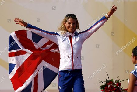 Bryony Shaw of Great Britain Celebrates Her Bronze Medal at the Medal Ceremony For the Rs:x Women's Windsurfing Event in Qingdao China 20 August 2008 Yin Jian of China Won Gold Giving China Its First Ever Olympic Sailing Gold and Italys Alessandra Sensini Won Silver